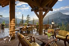 roger wade studio architectural photography of luxury rustic timber frame covered patio looking out to mountain view and lone peak, private residence, yellowstone club, montana, by locati architects, design associates and schlauch bottcher construction