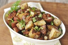 Potatoes roasted in olive oil and then coated in balsamic vinegar, bacon and herbs!  This potato salad is just as good warm as it is at room temperature.  In fact, it is best to let it cool for a while before you add the balsamic vinegar mixture so it doesn't totally soak up into the warm potatoes.