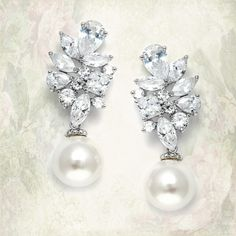 """LucyAlia's bridal earrings with cubic zirconia are 1 1/2"""" h x 9/16"""" w with a bold 12mm soft cream round pearl drop. Our silver rhodium earrings have a gorgeous cluster of oval, marquise, and round CZ's on the top with a simple pearl drop. These cubic zirconia earrings are sure to please any bride."""