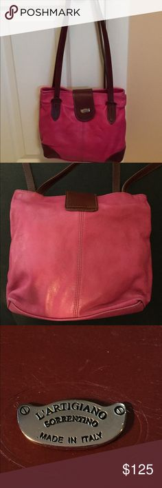 """Hot Pink L'Artigiano Italian Leather Shoulder Bag Once in a trip to the Amalfi Coast, I was captivated by a stunning hot pink leather shoulder bag. In a small shop, I bartered and bantered and I finally got the bag! Unfortunately, it now sits lonely in my closet, smaller than what I need (it's 10""""x12""""), and therefore unused. I'm looking to find it a good home! With two separate zippered compartments, this bag is both secure and practical. L'Artigiano/Sorrentino Bags Shoulder Bags"""