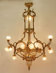 A Very Fine and Large French Belle Epoque Century Louis XIV Style Twelve-Light Gilt-bronze Figural Chandelier with frosted glass shades. The ovoid shaped body with scrolled acanthus corona suspending a medallion symbolic of Louis XIV, the Sun Kin Bronze Chandelier, Antique Chandelier, Antique Lighting, Chandelier Lighting, Kitchen Lighting Design, Art Nouveau, Tiffany Lamps, Vintage Lamps, Belle Epoque