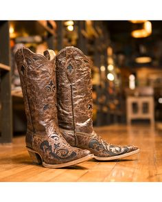 Corral Cowgirl Boots  http://www.countryoutfitter.com/products/39976-womens-sienna-full-quill-ostrich-navy-spyker-calf-boot/?lhb=style&lhs=p