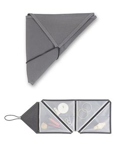 Umbra Tangram Travel Organizer.  Inspired by origami, this compact, triangular organizer provides portable, flat storage with a variety of pockets for your toiletries & other stuff. It appears to be geared to women but organized luggage should be equal opportunity. $10
