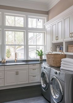 A row of windows above the sink bring plenty of natural light into this beautiful laundry room. Countertop is Black Absolute granite.