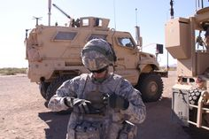 A Soldier with 2nd Brigade, 1st Armored Division, demonstrates a Nett Warrior device during the Network Integration Evaluation 12.1, Nov. 16, 2011, at White Sands Missile Range, N.M.  Photo Credit: Claire Schwerin, PEO C3TA.  WASHINGTON (Army News Service, June 29, 2012) -- Army leaders said plans are underway to deliver eight brigade combat teams of integrated, capability-enhancing networking technologies beginning in October.