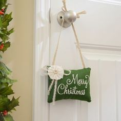 Leave your guests smiling with the Merry Christmas Door Hanger. #Kirklands #CozyChristmas #holidaydecor