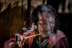 """An elderly woman in Myanmar is one of the last of her tribe to have intricate facial tattoos. """"The tribes first began to ink their faces as a way of disfiguring their beauty, to make themselves unattractive in hopes that by doing so, they could avoid being kidnapped or chosen as concubines by the Burmese kings,"""" explains Your Shot photographer Han Lin Teh."""
