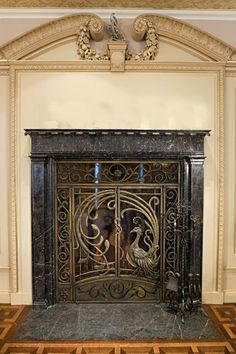 Bronze peacock fire screen and iron fireplace tools.. Can I please be Samuel Yellin when I grow up?!?