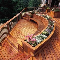 Lovely deck flowerbed. I want this deck so pretty.