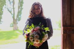 Finished wedding bouquet by Leslie Schott of 'Forest Beach Flowers' at Floret Flower Farm in Washington state, Skagit Valley.