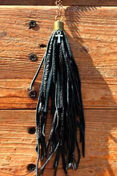 Made from real leather and has been recycled (its eco friendly) which I think adds to the post apocalyptic beauty, in a tassel I added ankh cross.