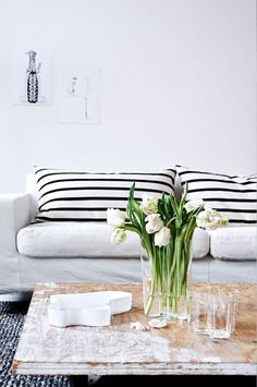 Striped cushions are a great living room update. Pair with flowers and distressed furniture for a Parisian feel. Home Living Room, Living Room Decor, Living Spaces, Living Room Inspiration, Home Decor Inspiration, Striped Cushions, Striped Sofa, Sofa Cushions, Black Cushions