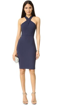 Wide straps crisscross the front of this formfitting LIKELY dress. Hidden back zip and vented hem. Sleeveless. Lined.