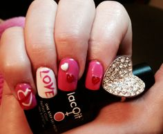 Fun valentines nails with LacQit Www.lacqit.com  All nail art done with LacQit colors . One step , all in one gel polish instantly dry to the touch right out of the lamp.   Simply Paint over LacQit without filing or removal for fun nail art of to change your color