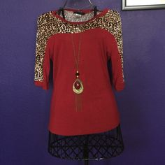 Burgundy and Leopard Contrast Half Sleeve Top Sassy burgundy knit top with leopard trim from a boutique.  Necklace came with top & will be sold that way.  Never worn. Tops Blouses