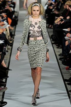 Love the print of the suit, not so much a fan of the blouse as an outfit... Oscar de la Renta