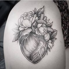 Surrealist anatomical heart on the thigh. Tattoo Artist: Alex Tabuns