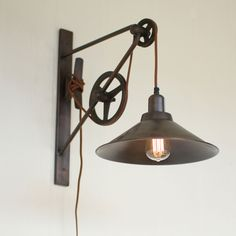 Widely regarded as a mechanical achievement, the old school pulley system made things work. This wall bracket light with an over/under pulley allows you to adjust the height with ease. Farmhouse Wall Sconces, Farmhouse Dining Room Lighting, Farmhouse Lamps, Rustic Farmhouse, Rustic Wood, Sconces Living Room, Dining Room Walls, Modern Industrial Decor, Industrial Lighting