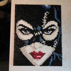 Michelle Pfeiffer as Catwoman. Made with perler and photo pearl beads. Perler Beads Pegboard, Diy Perler Beads, Perler Bead Art, Pearler Beads, Fuse Beads, Melty Bead Patterns, Hama Beads Patterns, Beading Patterns, Pixel Art
