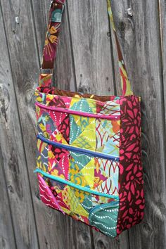 This versatile andfabulous cross-body bag sewing pattern by Sew Sweetness features fivezippered exterior pockets and an adjustable strap that allows you toconvert