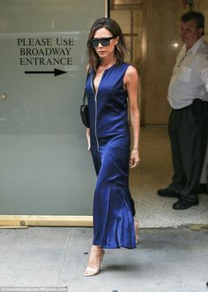 Stylishly stepping forward! Victoria Beckham displayed her petite frame in a daring midnight blue culotte jumpsuit
