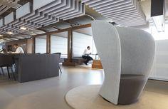 Open space office design by Casper Schwarz C4ID. Acoustic baffles ceiling. Globezero4 Shelter chair. Cubicals meeting space. Unique flagship store Rotterdam.
