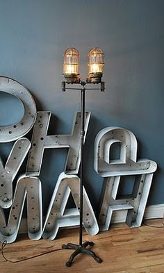 Letras de neon. combo kleur behang, witte plint, vloer, lamp en letters    industrial lamp in front of large letters - very cool  fatshackvintage.com.au + http://www.facebook.com/pages/Fat-Shack-Vintage/173244872787161