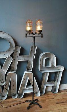 Letras de neon. combo kleur behang, witte plint, vloer, lamp en letters    industrial lamp in front of large letters - very cool  fatshackvintage.com.au + http://www.facebook.com/pages/Fat-Shack-Vintage/173244872787161