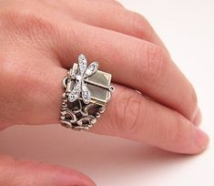 Possible Dragonfly ring, with a locket behind the dragonfly for a 12x14 mm picture.