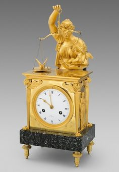 A French Empire Ormolu Mantle Clock                                                                                                                                                                                 More