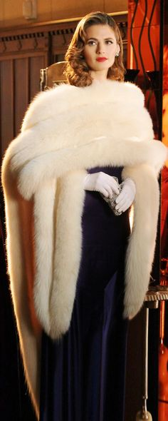 ok... there is nothing comfy about this...but it reminds me of my Barbie clothes and how I wanted to play dress up when I was a little girl.........faux fur of course...very princess Grace