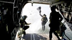 Marine Raider with 1st Marine Raider Battalion jumps from the ramp of a CH-47 Chinook helicopter into the ocean during helocast training. [57603240]