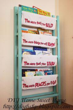 Repurposed crib into book storage .. I love the Dr. Seuss quote on the fabrics.