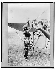 Harriet Quimby turning over plane propeller, 1911. Notice the three-cylinder Anzani motor. This training aircraft was part of the Moisant flying school, where Harriet became the first woman to earn a pilot license in the United States (second in the world).