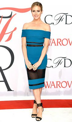 Brittany Snow turned heads in an off-the-shoulder, teal dress with sheer panels, a black purse, and sandals.