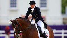 Anne Van Olst of Denmark riding Clearwater celebrates while competing in the Team Dressage Grand Prix Special on Day 11 of the London 2012 Olympic Games at Greenwich Park