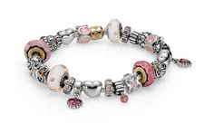 Pandora - We love this design in silver, pale pink and a splash of gold. www.pollocksjewelers.com