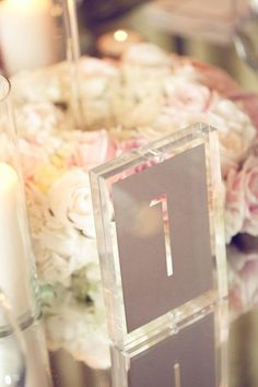 modern wedding table numbers / http://www.himisspuff.com/acrylic-and-lucite-wedding-decor-ideas/6/