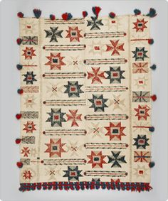 """Bedspread (couvre boutonné).  Quebec. 1920 - 1940. Cotton and wool yarns, woven and sewn. Textile Museum of Canada """"Weavers in Québec use weft-loop weave or boutonné to pattern their plain weave blankets. The loops are made by pulling up the weft threads as they are inserted into the warp threads held in tension by the loom. This method is free and creative because the weaver, not the loom, controls the creation of the pattern."""" -- Textile Museum of Canada"""