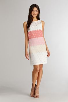 A unique texture combine with pretty pastel colors compliments this organza sheath dress.