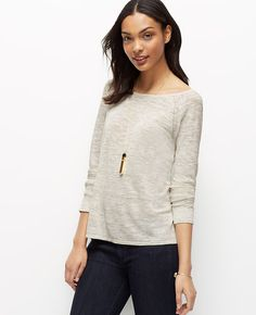 Styled with a modern split back, this fabulously fitted sweater flaunts covetably versatile style. Boatneck. Long raglan sleeves with diagonal rib and pointelle detail at armhole seams. Back placket with pointelle detail. Hi-lo hem with back slit.