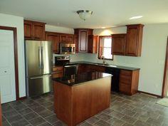 Kitchen of a Blossburg II (13-45M)  Granite Countertops and kitchen cabinets