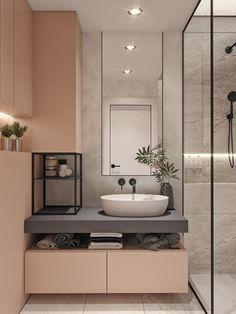 Para quem adora ambientes com cor, este banheiro é pura inspiração! O rosa suave dos armários ganhou a companhia de elementos cinza chumbo e metais em preto, tudo lindo e sem excessos!