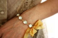 So very gorgeous. Vintage Jewel Bracelet with Gold Ribbon. The Duchess. 14k Gold Filled. $42.00, via Etsy.
