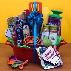 Color is a great way to pull together the whole look of any gift basket. Pick the signature item [in this basket it's the measuring cups/spoons]. Buy others to match the color story. Keep the color theme going w/a coordinating dishtowel. Finish off w/exotic spices, infused oils, and aged vinegar. Bon appétit!