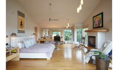 Sagaponack Home Pictures - DuJour. Things I realllly like:  the move-able TV stand with NO  ugly cable cords, and the spacious interior with a great view + comfortable fireside seating!