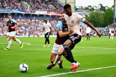 Marcus Rashford of Manchester United and Phil Bardsley of Burnley clash leading to a red card for Rashford during the Premier League match between Burnley FC and Manchester United at Turf Moor on. Burnley Fc, Marcus Rashford, Premier League Matches, Manchester United, The Unit, Running, Sports, Red, Hs Sports