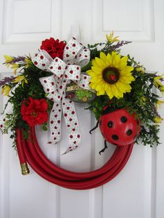 RED GARDEN HOSE Wreath Ladybugs  ***This is adorable...and I could totally copy it for under $30, so YAY!*** What a cute spring door decorations.