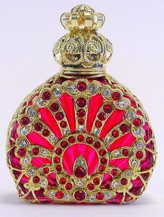 Red and white crystals grace this Czech perfume bottle. Beautiful!
