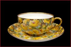 Charming hand painted porcelain cup and saucer set by Charles Ahrenfeldt, Limoges, France 1894-1930